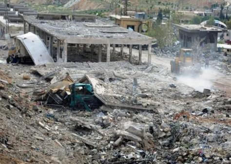 Bâtiments de la banlieue de Damas, bombardés par l'aviation sioniste - Photo : AFP/SANA