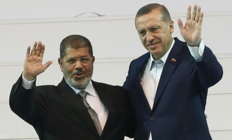 Turkey's PM and leader of ruling AKP Erdogan and Egypt's President Mursi greet the audience during the AKP congress in Ankara