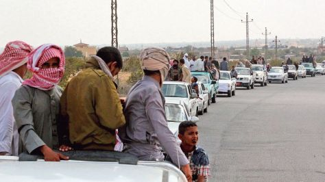 A funeral convoy carrying the bodies of four Islamist militants drives through Sheikh Zuweid, in the north of the Sinai peninsula