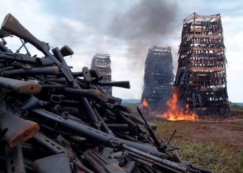 Rwandan weapons burn near the Rwandan capital of Kigali April 14, 2005. Rwanda burnt a heap of guns,..