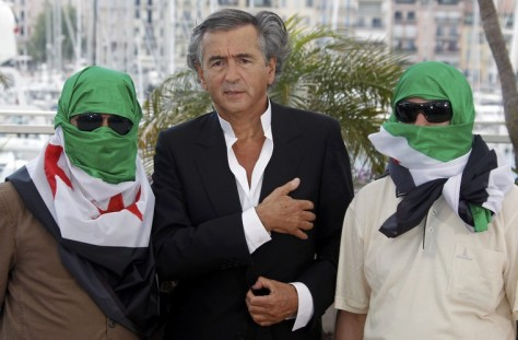 Director Levy and two unidentified men pose during a photocall for the film Le Serment de Tobrouk at the 65th Cannes Film Festival