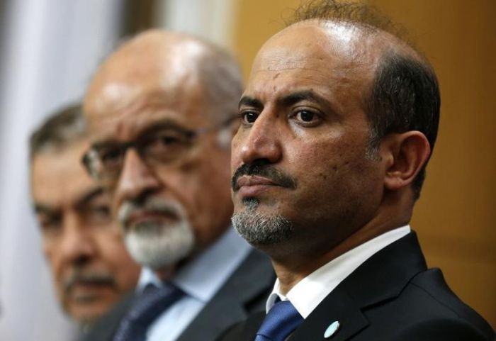 559988-syrian-opposition-chief-jarba-speaks-at-a-news-conference-in-london