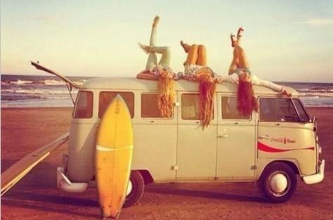 three_girls_laying_on_minivan