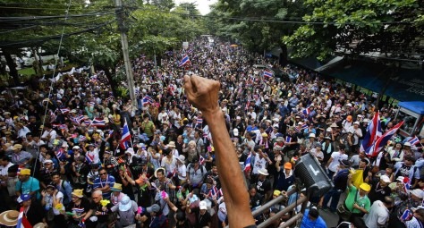 Anti-government protesters gather outside the Labour Ministry in Bangkok